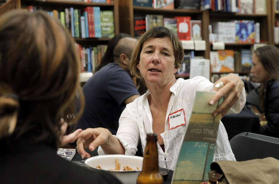 Author Marian Palaia tells her group about the book she chose during a book swap at Booksmith. Photo: Carlos Avila Gonzalez, The Chronicle