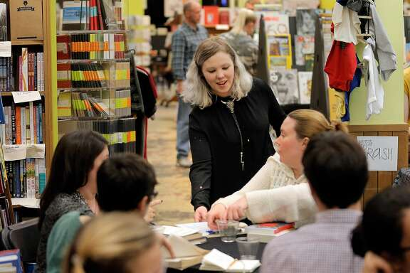 Coley Gold, events manager for Booksmith, check on guests during a Book Swap event at Booksmith Book Store in San Francisco, Calif., on Thursday, October 20, 2016. Book stores have seen a decline in business in recent years, forcing some to close, but Booksmith on Haight has not only made a go of it, they are expanding. By becoming a gathering spot for the neighborhood and putting together over 200 events a year, business is steady.