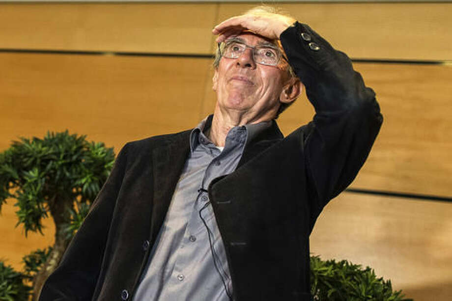 """France's Jean-Pierre Sauvage arrives for a press conference at the Strasbourg university, eastern France, Wednesday Oct. 5, 2016. Sauvage, British-born Fraser Stoddart and Dutch scientist Bernard """"Ben"""" Feringa share the 8 million kronor ($930,000) prize for the """"design and synthesis of molecular machines,"""" the Royal Swedish Academy of Sciences said. (AP Photo/Jean-Francois Badias)"""