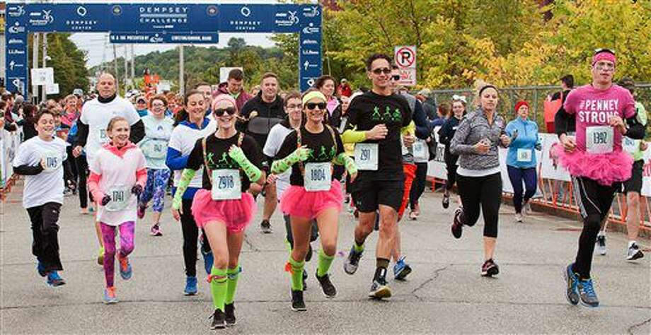 """Audrey Hamel, 2918, and Morgan Giard, 1804, are at the front of the pack of the 5K race/walk at the Dempsey Challenge Saturday, Oct. 1, 2016 in Lewiston, Maine. Patrick Dempsey, who plays a starring role in the new romance-comedy, """"Bridget Jones's Baby,"""" participated Saturday in a cancer survivor walk with his three children and two sisters. (Russ Dillingham/The Lewiston Sun-Journal via AP)"""
