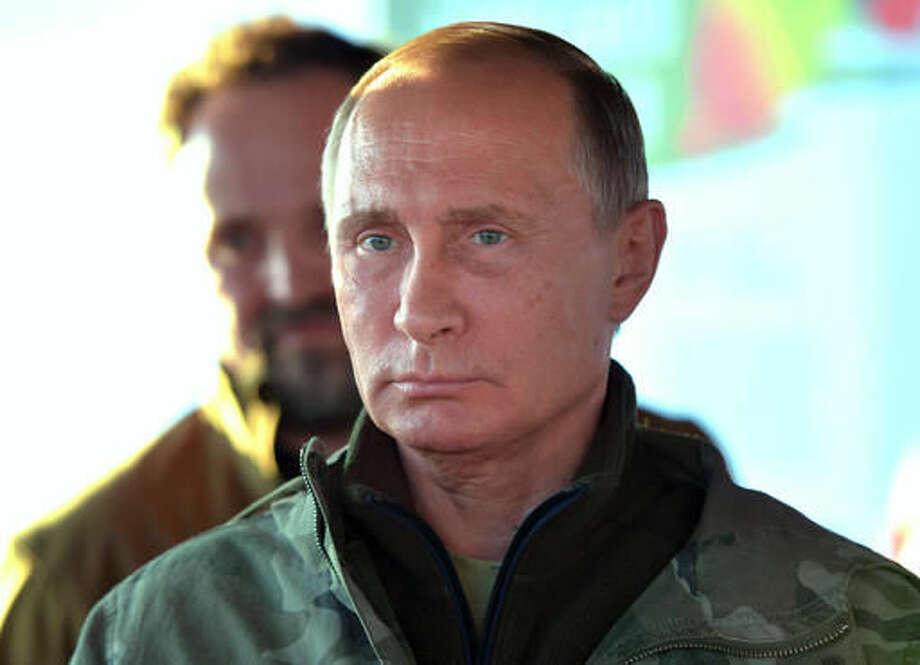 Russian President Vladimir Putin visits a reserve for wild horses near the Urals city of Orenburg, about 1300 kilometers (800 miles) southeast of Moscow, Russia, Monday, Oct. 3, 2016. (Alexei Druzhinin/Sputnik, Kremlin Pool Photo via AP)