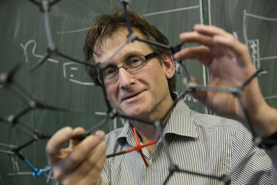 "This is a image taken on Nov. 28, 2013 made available by the University of Groningen on Wednesday Oct. 5, 2016 of Dutch scientist Bernard ""Ben"" Feringa. Feringa was one of the three scientists who won the Nobel Prize in chemistry on Wednesday for developing the world's smallest machines, work that could revolutionize computer technology and lead to a new type of battery. (Jeroen Van Kooten/University of Groningen via AP)"
