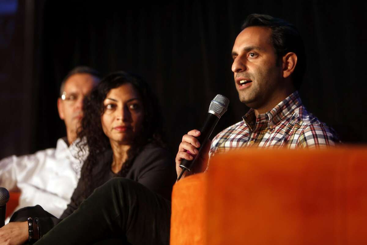 Ali Vahabzadeh, Chariot CEO & Co-founder, (right) speaks during a panel discussion as Monali Shah, HERE's Director of Intelligent Transportation, and Jiri Marek, Bosch Senior VP at Research and Technology Center, listen during C3 Group's Connected Mobility Summit in San Francisco, Calif., on Thursday, October 20, 2016.