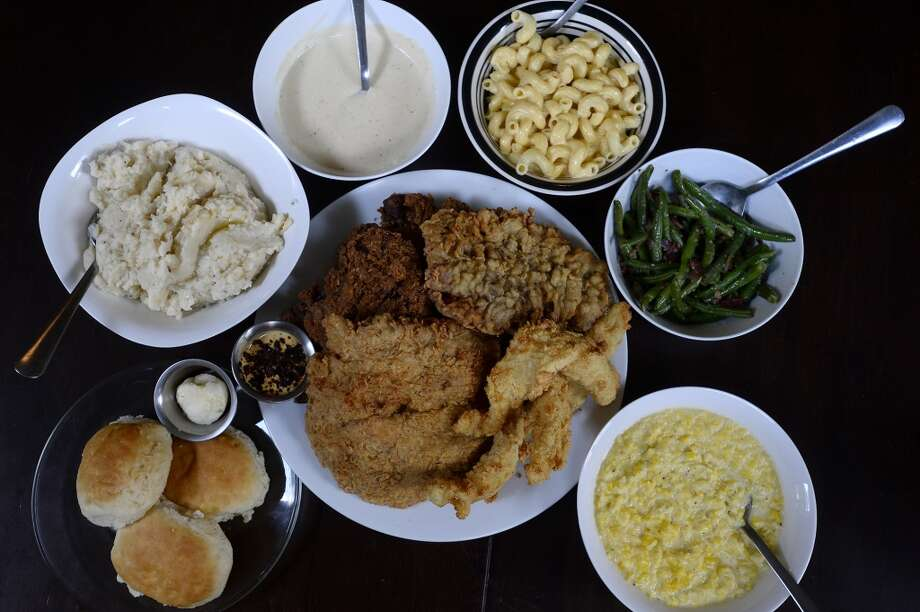 Meals at Republic Chicken are served family style, with a serving of meat and a variety of sides to go with it.  Photo taken Tuesday 10/11/16 Ryan Pelham/The Enterprise Photo: Ryan Pelham/The Enterprise