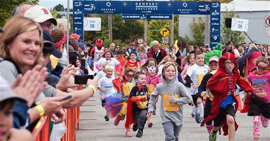 """Children take part in the Kids' Fun Run during the annual Dempsey Challenge Saturday, Oct. 1, 2016 in Lewiston, Maine. Patrick Dempsey, who plays a starring role in the new romance-comedy, """"Bridget Jones's Baby,"""" participated Saturday in a cancer survivor walk with his three children and two sisters. (Russ Dillingham/The Lewiston Sun-Journal via AP)"""
