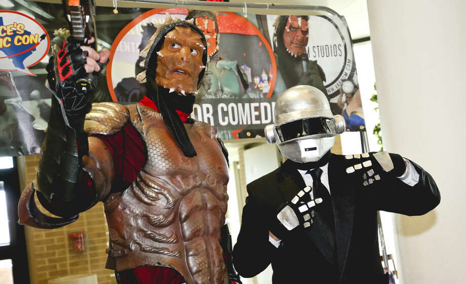 In this January 2015 file photo, comedian Alien Warrior, left, poses for a photo with Daft Punk cosplayer Adrian Salcedo during the South Texas Collector's Expo Comic Con at the TAMIU Student Center.