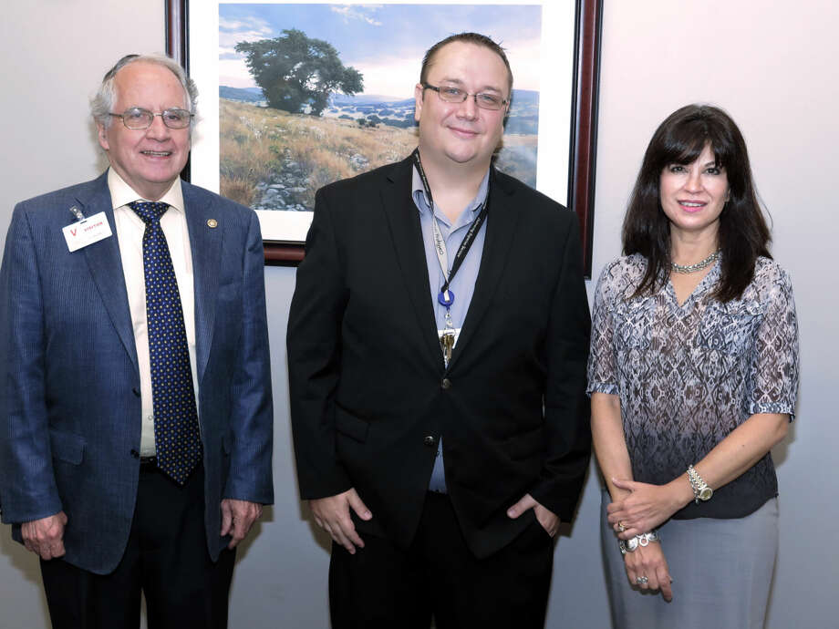 Convergys General Manager Michael Tufts, center, met, Wednesday at his office with Laredo Development Foundation Board of Directors President Bill Green, who is also the Laredo Morning Times publisher, and foundation Executive Director Olivia Varela.