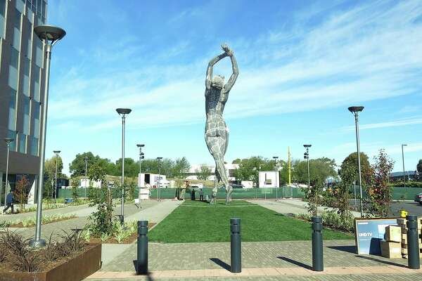 """In this photo taken Wednesday Oct. 19, 2016, a 55-foot nude statue stands in San Leandro, Calif. The statue of a naked woman is stirring controversy and a lot of conversation. City officials and the sculptor of the steel nude, which was unveiled this week across from San Leandro's main commuter train stop, say they want to draw attention to """"feminine energy."""" Critics say the 13,000-pound towering nude is not appropriate public art."""