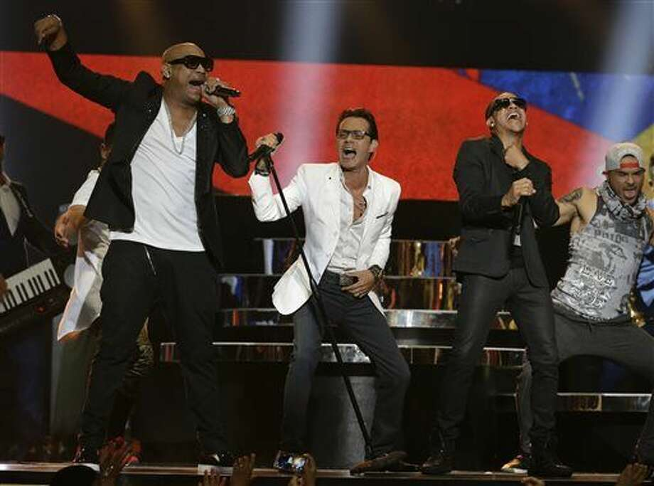 Singer Marc Anthony, center, performs with the Cuban duo Gente de Zona during the Latin Billboard Awards, Thursday, April 30, 2015 in Coral Gables, Fla.