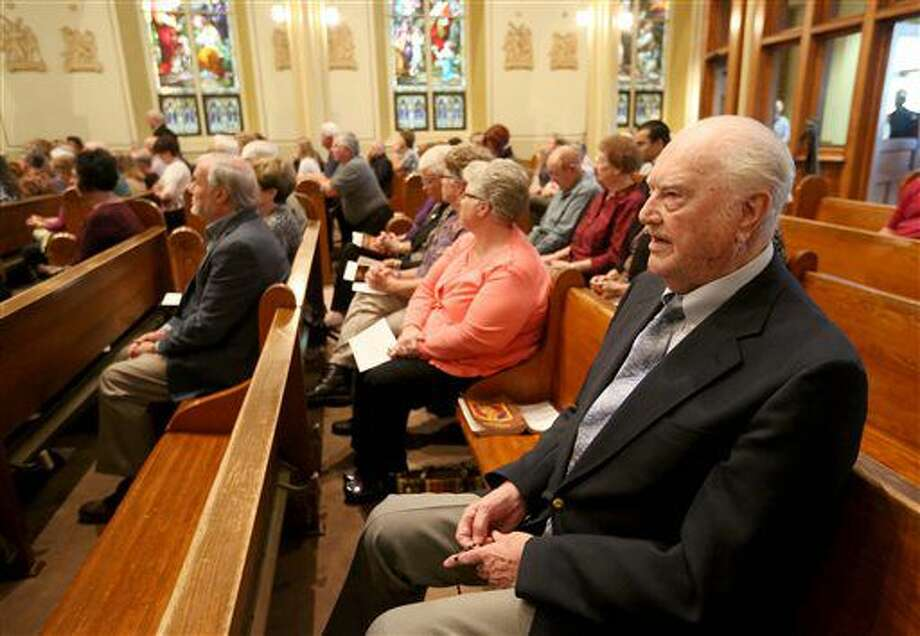 Lee Stammeyer, of St. Lucas, Iowa, leads a prayer before a Mass of remembrance for Chaplain Aloysius Schmitt on Wednesday, Oct. 5, 2016, at St. Luke's Church in St. Lucas, Iowa. Schmitt, a St. Lucas, native, died on Dec. 7, 1941, when the Japanese attacked Pearl Harbor. After nearly 75 years, his remains have been identified. (Jessica Reilly/Telegraph Herald via AP)