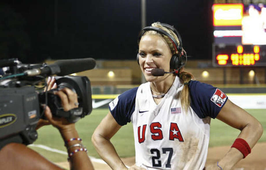 """FILE - In this Monday, July 26, 2010 file photo, USA's Jennie Finch talks with the media following the World Cup of Softball Championship game against Japan in Oklahoma City. A former contestant on the reality television show """"The Apprentice,"""" Finch says the show's star, Donald Trump, """"was extremely supportive. You could tell there was so much respect there on all sides, especially with the female athletes. … Obviously, he was complimentary, but never in an inappropriate way."""" (AP Photo/Alonzo Adams)"""