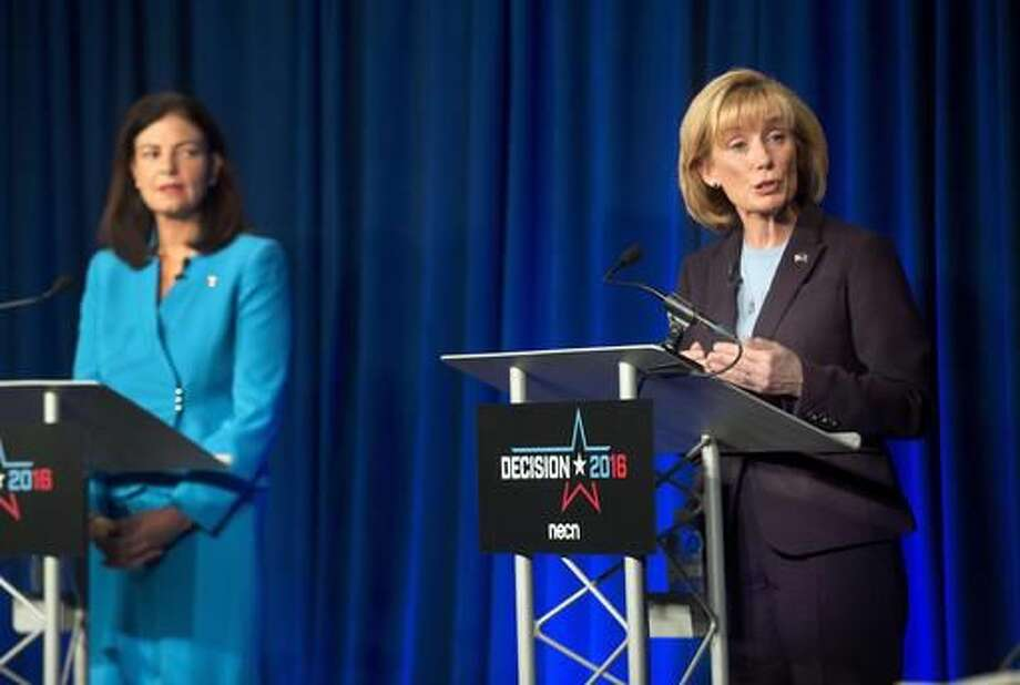 Incumbent Republican U.S. Sen. Kelly Ayotte, left, listens as Democratic challenger Gov. Maggie Hassan speaks during a live televised debate by New England Cable News at New England College Monday, Oct. 3, 2016, in Henniker, N.H. (AP Photo/Jim Cole)
