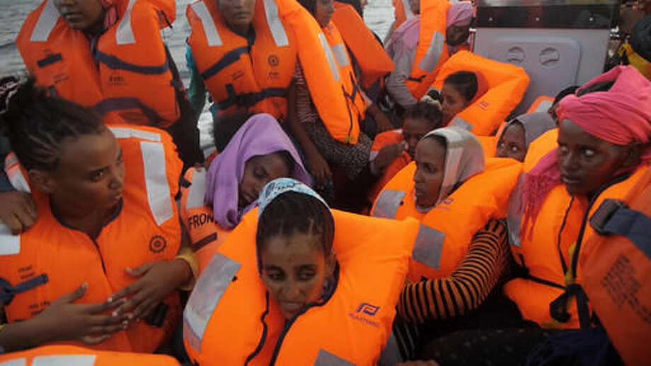 A rescue boat is filled with migrants taken from a vessel in the Mediterranean Sea off the coast of Libya in this Tuesday Oct. 4, 2016 image taken from video. At least 33 people died on Tuesday trying to reach Europe by crossing the Mediterranean Sea from Libya.(AP Photo)
