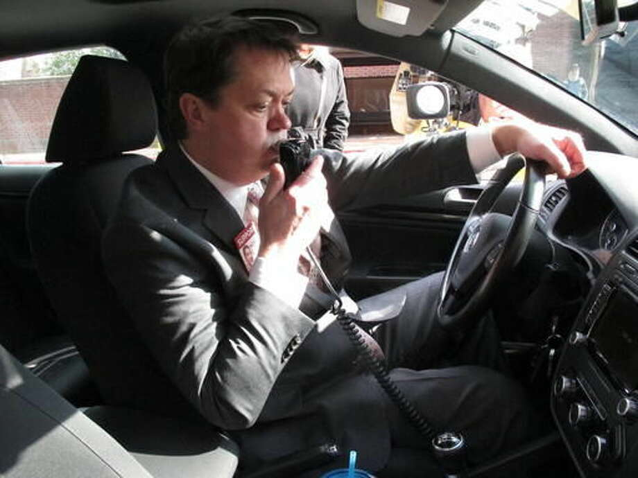 This Feb. 10, 2016 photos, Andrew Wisniewski, an operations manager for Smart Start of Maryland, demonstrates how an ignition interlock device works in Annapolis, Md. The devices are put in cars to stop drunk drivers from operating their vehicles. A law requiring the devices for first-time offenders, rather than just ones arrested with more than twice the legal limit of alcohol in their systems, takes effect Oct. 1. (AP Photo/Brian Witte)