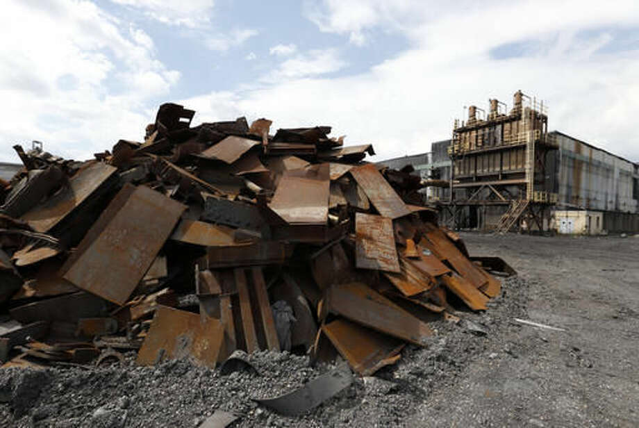 In this Thursday, Sept. 8, 2016, photo, a pile of rubble lies next to a dust collector for a carbon storage room of the former Ormet plant, at the site in Hannibal, Ohio. For decades, many workers in the area found work at the aluminum plant...union jobs, with good pay and generous benefits. But due to stiff price competition from China, the plant closed in 2014. Republican presidential candidate Donald Trump is viewed as a champion to many here who say America's political leaders have stood by while competition from China and other countries has wrecked communities like Hannibal. (AP Photo/Paul Vernon)