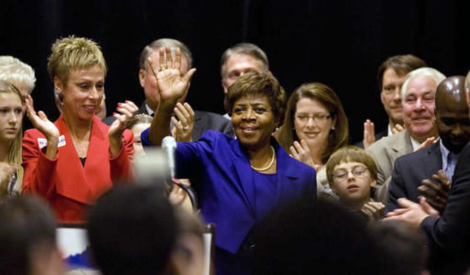 FILE - In this Nov. 6, 2012 file photo, Democrat Linda Coleman waves to supporters on Election Day, at a Marriott City Central ballroom in downtown Raleigh, N.C. Lt. Gov. Dan Forest and challenger Coleman, who debated Tuesday night, Sept. 13, 2016, tied themselves tightly to the positions dug out by their respective parties on education funding, House Bill 2 and other issues in what could be their only head-to-head debate before Election Day. The election is a rematch of 2012, when Forest narrowly topped Coleman by nearly 7,000 votes out of 4.4 million cast. (Corey Lowenstein /The News & Observer via AP, File)