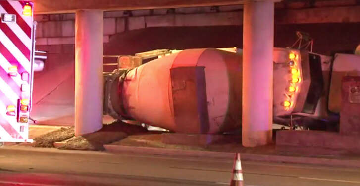 A cement truck overturned early Friday morning, snarling portions of the U.S. 59 service road in southwest Houston.