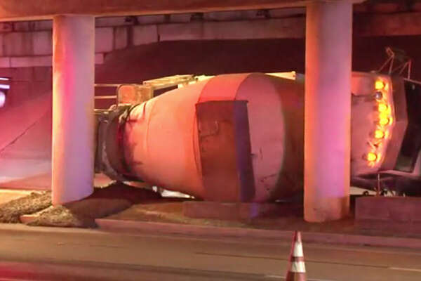 A cement truck overturned early Friday morning, snarling portions of the U.S. 59 service road in southwest Houston.  The single-vehicle crash happened about 4:45 a.m. on the inbound U-Turn lane of the Southwest Freeway service road at Weslayan, according to Houston TranStar.