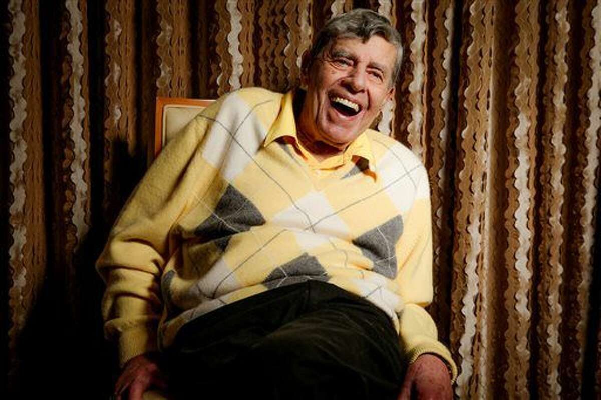 In this Aug. 24, 2016 photo, comedian Jerry Lewis reacts during an interview at the Four Seasons Hotel in Los Angeles. Getting older has been frustrating. At 90, Lewis sometimes loses his train of thought and uses a cane and a wheelchair to get around. But his desire to connect with audiences, and with people, is undiminished.
