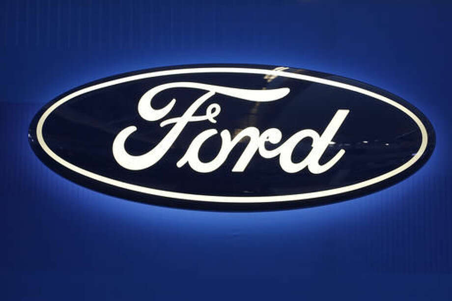 FILE - This Feb. 11, 2016, file photo shows the Ford logo on display at the Pittsburgh International Auto Show in Pittsburgh. Ford is adding about 1.5 million cars, SUVs and vans to a recall for doors that can pop open while the vehicles are moving. The company says it's adding the vehicles at the request of the U.S. National Highway Traffic Safety Administration. (AP Photo/Gene J. Puskar, File)