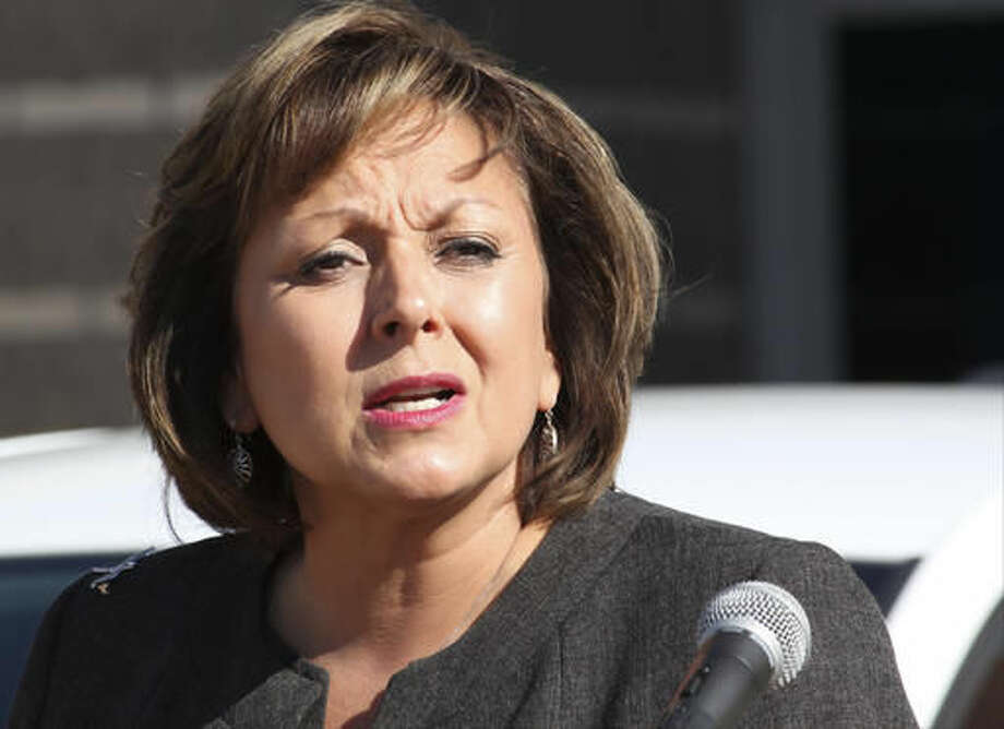 FILE - In this Aug. 18, 2016, file photo, New Mexico Gov. Susana Martinez welcomes the ride-booking company Lyft back to the state during a news conference in Albuquerque, N.M. Republican Gov. Martinez's administration and Democratic state lawmakers exchanged more blame Thursday, Sept. 8, 2016, for inaction as New Mexico grapples with a growing budget deficit. (AP Photo/Susan Montoya Bryan, File)