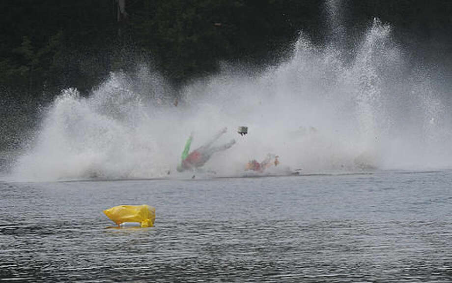 One on the racers goes airborne during a fatal crash Saturday, Sept. 10, 2016, during the Bill Giles Memorial Regatta on Watson Pond in Taunton, Mass. Authorities said multiple speed boats collided during the race. (Mike Gay/The Daily Gazette via AP)