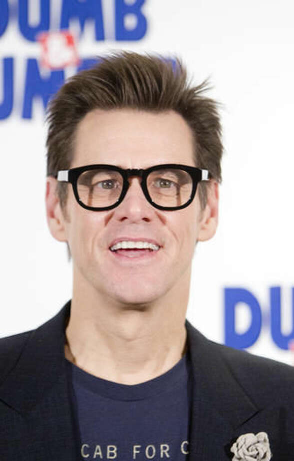 "File- This Nov. 20, 2014, file photo shows Jim Carrey posing for photographers for the ""Dumb and Dumber To"" photo call in Paris, France. Carrey says a wrongful death lawsuit filed by the husband of his ex-girlfriend is a heartless attempt to exploit him. Mark Burton sued Carrey in Los Angeles Superior Court on Monday, Sept. 19, 2016, accusing the actor of providing the prescription drugs Cathriona White used to overdose in September 2015. The wrongful death lawsuit contends Carrey improperly obtained prescriptions for Ambien and the powerful opioid oxycodone under the alias Arthur King. (AP Photo/Jacques Brinon, File)"