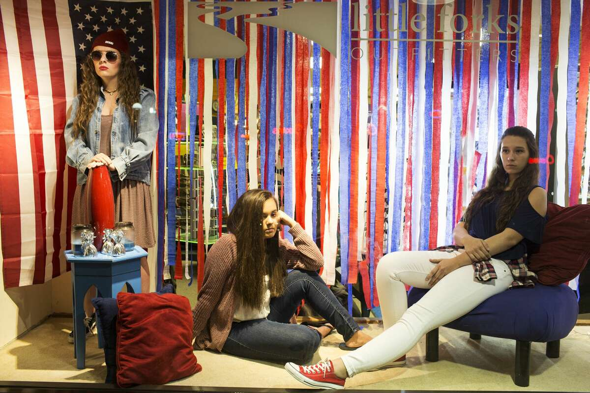Northwood University students Kendall Glaze, Briana Ford, and Haley Sharp model as mannequin during Mannequin Night in Downtown Midland on Thursday. Mannequin Night is sponsored by the Northwood University Fashion Marketing & Management Department and the Midland Downtown Business Association.