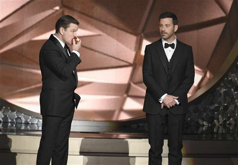 Matt Damon, left, and host Jimmy Kimmel appear on stage at the 68th Primetime Emmy Awards on Sunday, Sept. 18, 2016, at the Microsoft Theater in Los Angeles. (Photo by Chris Pizzello/Invision/AP)