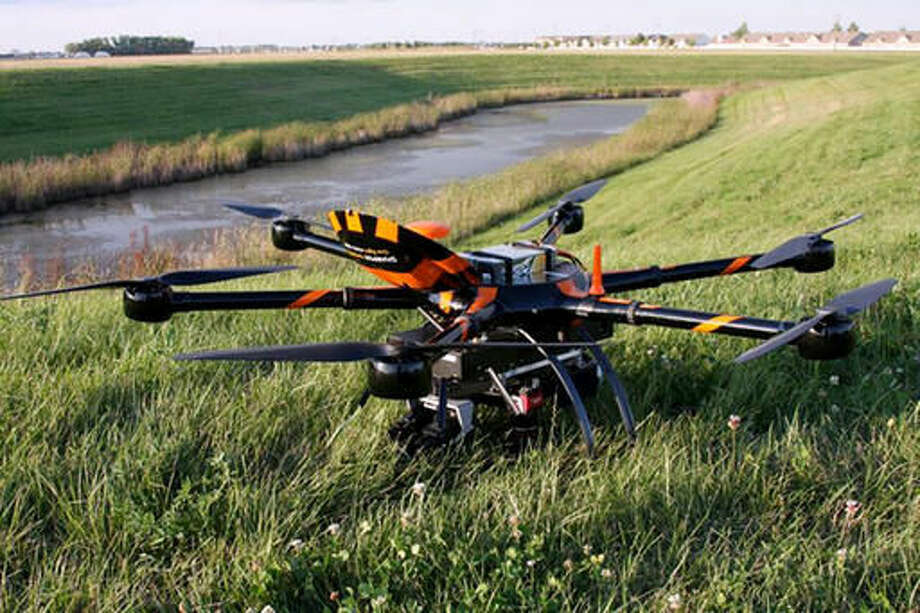 FILE - This Aug. 29, 2016, file photo provided by Sharper Shape and SkySkopes shows a Sharper A6 drone before a test to fly over power lines in eastern North Dakota near Blanchard. The drone is specially designed for utility asset inspections. The drone is being tested as part of a project by Xcel Energy to see of unmanned aircraft can help crews restore power to areas hit by natural disasters. Officials with the company hope to be flying beyond visual line of sight by the end of the year. (/Sharper Shape and SkySkopes via AP, File)