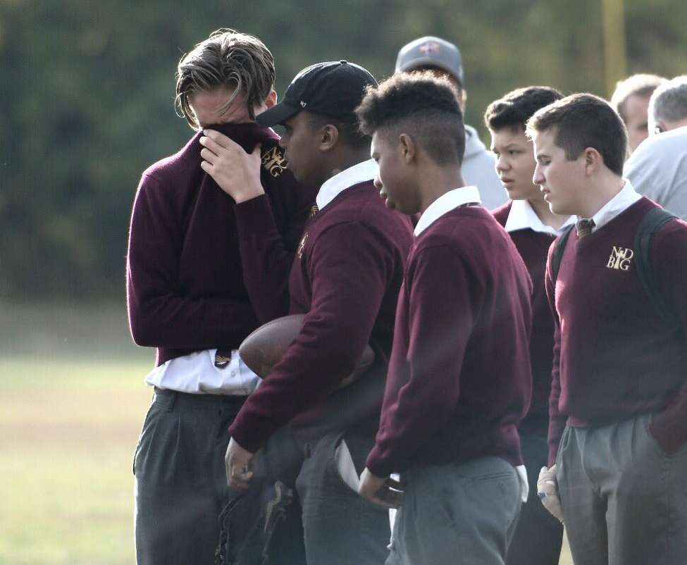 Members of the Holy Trinity football team are in shock on Friday, Oct. 21, 2016, after a suspicious fire destroyed all their equipment the day before playoffs. (Skip Dickstein/Times Union)