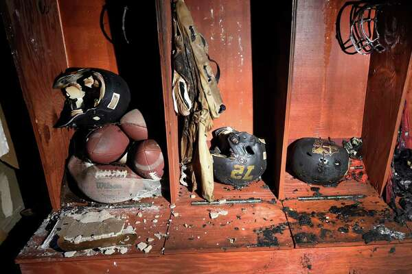 The Holy Trinity football team field house lays in ruin after an suspicious early morning fire Friday Oct. 21, 2016 in Schenectady, N.Y.  Head coach John Barber hand-built the lockers by hand.  (Skip Dickstein/Times Union)