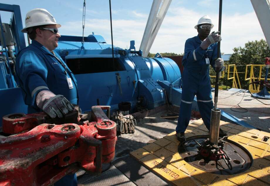 A Schlumberger crew performing hydraulic fracturing work on an oil well. After several years of struggling, oilfield service companies are beginning to raise prices for their products and services, according to a new report from industry research firm Rystad Energy.