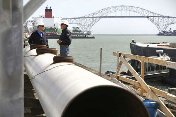 NuStar Energy LP employees talk at the construction site of a new crude oil tanker pier at NuStar's Corpus Christi terminal in 2013. NuStar has acquired more crude oil export assets at the Port of Corpus Christi.