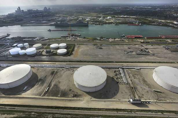 Three of the four crude oil storage tanks that hold 400,000 barrels at NuStar Energy Terminal at the Port Corpus Christi.