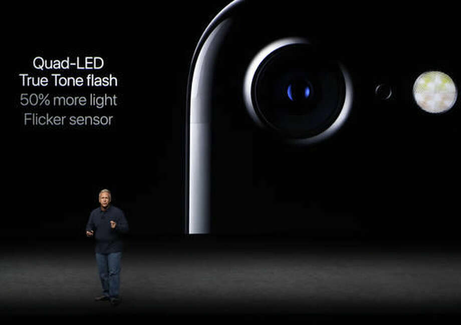 Phil Schiller, Apple's senior vice president of worldwide marketing, talks about the features on the new iPhone 7 during an event to announce new products, Wednesday, Sept. 7, 2016, in San Francisco. (AP Photo/Marcio Jose Sanchez)