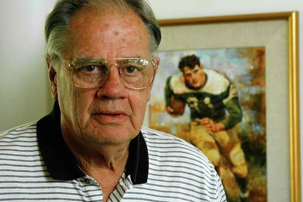 """Ken Hall, 70, who holds the all-time high school football rushing record, is shown at his home Wednesday, Sept. 20, 2006, in Fredericksburg, Texas. The painting in the background is from a photo made during his time at Sugar Land High School, where he was nicknamed the """"Sugar Land Express."""" From 1950 to '53 he rushed for 11,232 yards. The 4,045 rushing yards his senior year remain a national record for a 12-game season. (AP Photo/Harry Cabluck)"""