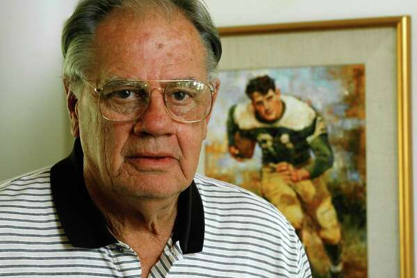 "Ken Hall, 70, who holds the all-time high school football rushing record, is shown at his home Wednesday, Sept. 20, 2006, in Fredericksburg, Texas. The painting in the background is from a photo made during his time at Sugar Land High School, where he was nicknamed the ""Sugar Land Express."" From 1950 to '53 he rushed for 11,232 yards. The 4,045 rushing yards his senior year remain a national record for a 12-game season. (AP Photo/Harry Cabluck)"