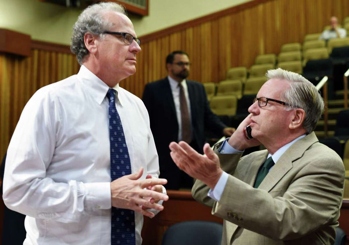 ESD president and CEO Howard Zemsky, left, and Assembly committee chair Robin Schimminger speak before the start of legislative hearings at the LOB on Gov. Cuomo's economic development programs Wednesday Aug. 3, 2016 in Albany, NY. (John Carl D'Annibale / Times Union)