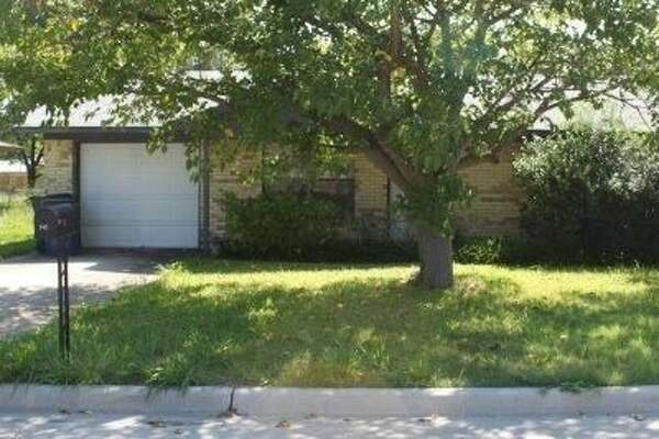 "This three-bedroom house at 108 Freese Drive in the North Texas community of Sanger is listed for sale ""as is"" on the website Realtor.com. (Photos: Realtor.com)"