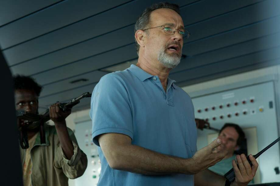 "This photo released by Sony - Columbia Pictures shows actor Tom Hanks in a scene from the film, ""Captain Phillips,"" releasing in the U.S. on Friday. Some amateur actors from Minneapolis made their film debut acting alongside the two-time Academy Award winner, Hanks. The four actors of Somali descent appear as Somali pirates in ""Captain Phillips,"" which stars Hanks as the captain of a cargo ship hijacked off the Horn of Africa in 2009. (AP Photo/Copyright Sony - Columbia Pictures, Hopper Stone, SMPSP)"