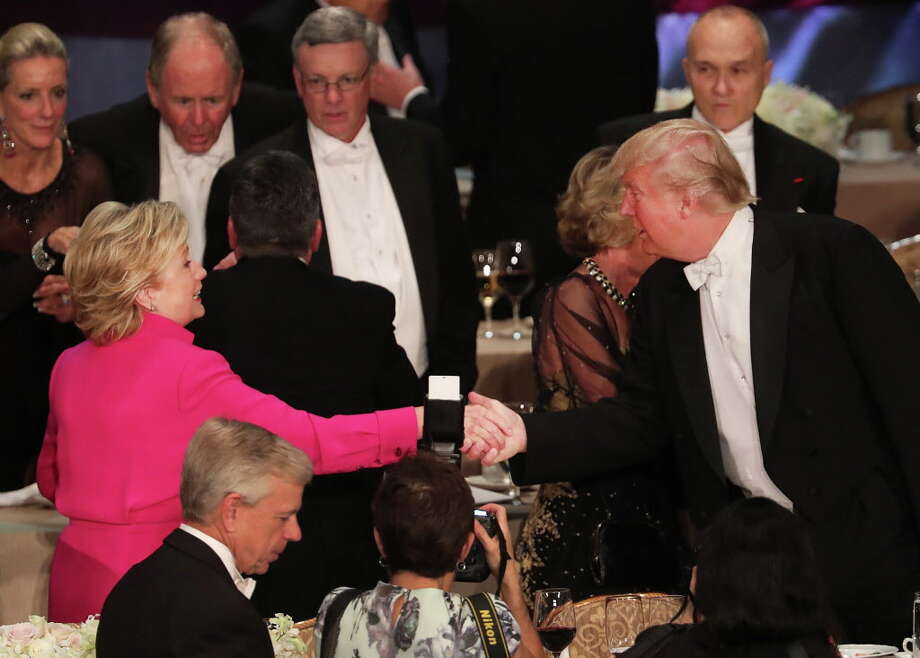 NEW YORK, NY - OCTOBER 20:  Hillary Clinton shakes hands with Donald Trump while attending the annual Alfred E. Smith Memorial Foundation Dinner at the Waldorf Astoria on October 20, 2016 in New York City.The white-tie dinner, which benefits Catholic charities and celebrates former Governor of New York  Al Smith, has been attended by presidential candidates since 1960 and gives the candidates an opportunity to poke fun at themselves and each other.  (Photo by Spencer Platt/Getty Images) *** BESTPIX *** ORG XMIT: 673478671 Photo: Spencer Platt, Getty / 2016 Getty Images