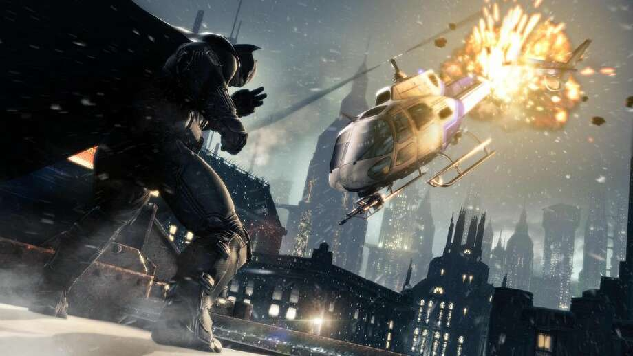 "This publicity photo released by Warner Bros. Interactive Entertainment shows a scene from the video game franchise ""Batman: Arkham Origins."" ""Origins,"" releasing worldwide on Oct. 25, 2013, is set several years before 2009's ""Arkham Asylum"" and its 2011 sequel ""Arkham City."" (AP Photo/Warner Bros. Interactive Entertainment, File)"