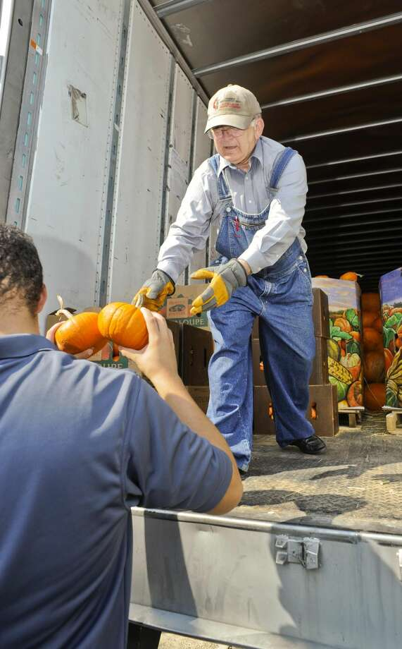 Parishioner Charles Whitfield unloads smaller pumpkins Tuesday afternoon as they are taken to the First United Methodist Church lawn, where the church will set up their annual pumpkin patch. (Photo by Danny Zaragoza/Laredo Morning Times)