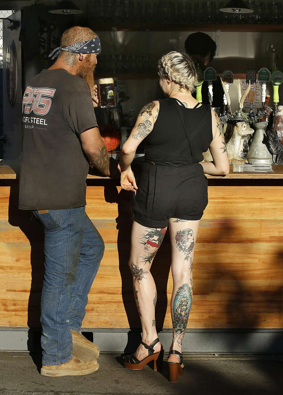 Patrons get beers at the bar at Biergarten on Thursday, October 20 ,2016, in San Francisco, Calif.
