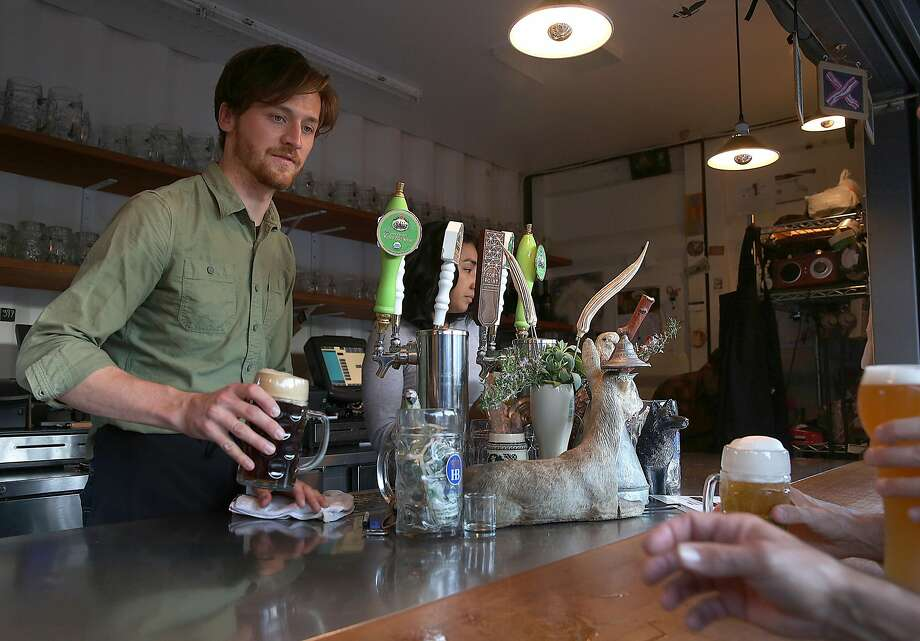Bartender Jonathan Turner serves brews at the Biergarten in Hayes Valley. Photo: Liz Hafalia, The Chronicle