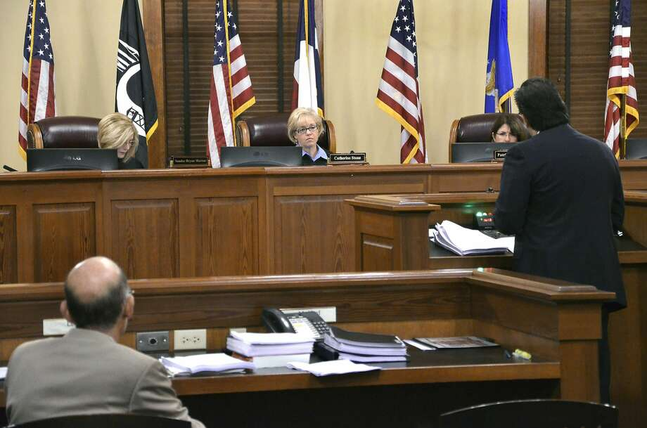 Texas Fourth Court of Appeals members, from left, Justice Sandee Bryan Marion, Chief Justice Catherine Stone and Justice Patricia O. Alvarez preside as local attorney Baldemar Garcia Jr., at podium, presents his arguments in a case involving Dr. Hector Farias representing VIDA (Voices in Democratic Actions) and local businessman Eduardo Garza. The case was heard Thursday morning at the Commissioners Courtroom at the Webb County Courthouse.