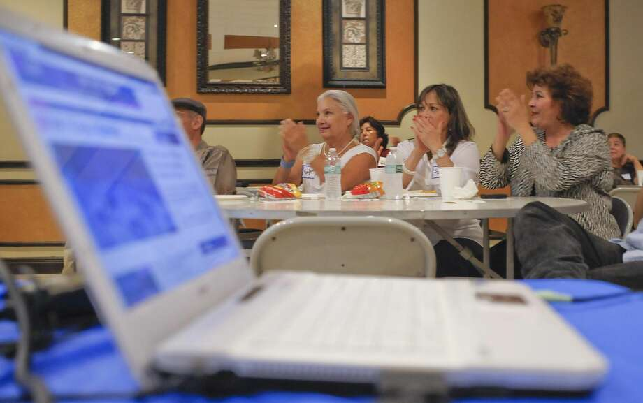 It's official: Davis is runningSylvia Palumbo, left, Irma Garcia and Eva Ramirez clap as they watch a live broadcast of state Sen. Wendy Davis announcing her candidacy for governor of Texas on Thursday afternoon at the Firefighters Union Hall. (Photo by Danny Zaragoza/Laredo Morning Times)