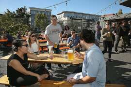 Students visiting from University of North Carolina including Thu Pham (left)  have beers at Biergarten  on Thursday, October 20, 2016, in San Francisco, Calif.
