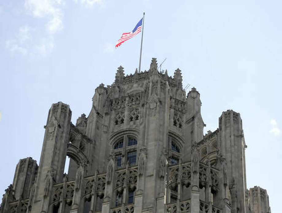 FILE - This April 25, 2016, file photo shows the top of the Tribune Tower on Michigan Avenue in Chicago. Tribune Media has completed the sale of several real estate assets, including the Tribune Tower in Chicago. Tribune Media said Wednesday, Sept. 28, 2016, that it also closed on the sale of Los Angeles Times Square and Olympic Plant. (AP Photo/M. Spencer Green, File)